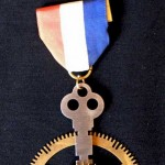 key-and-gear-medal